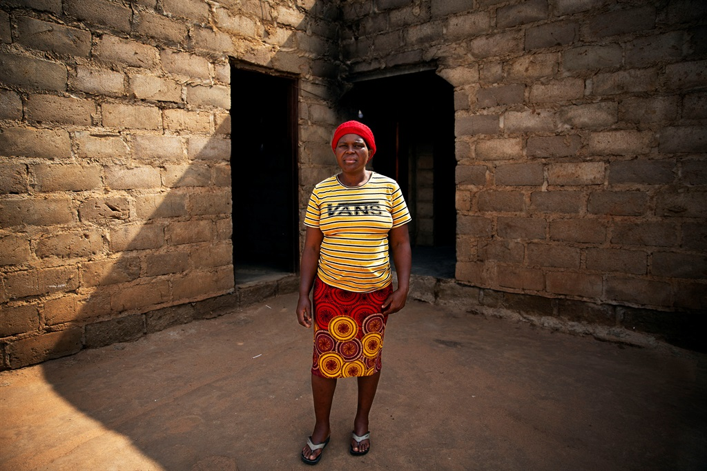 Rachel Mashego stands outside the home her ex-part