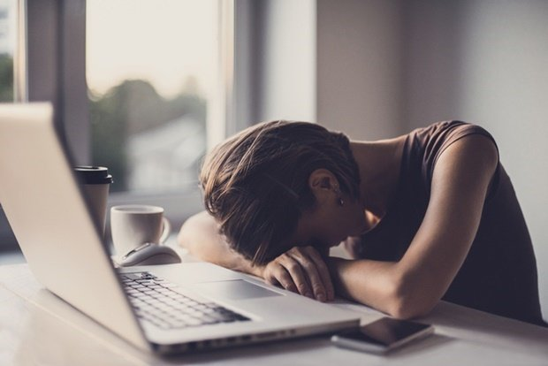 Businesswoman or student sleeping after hard work