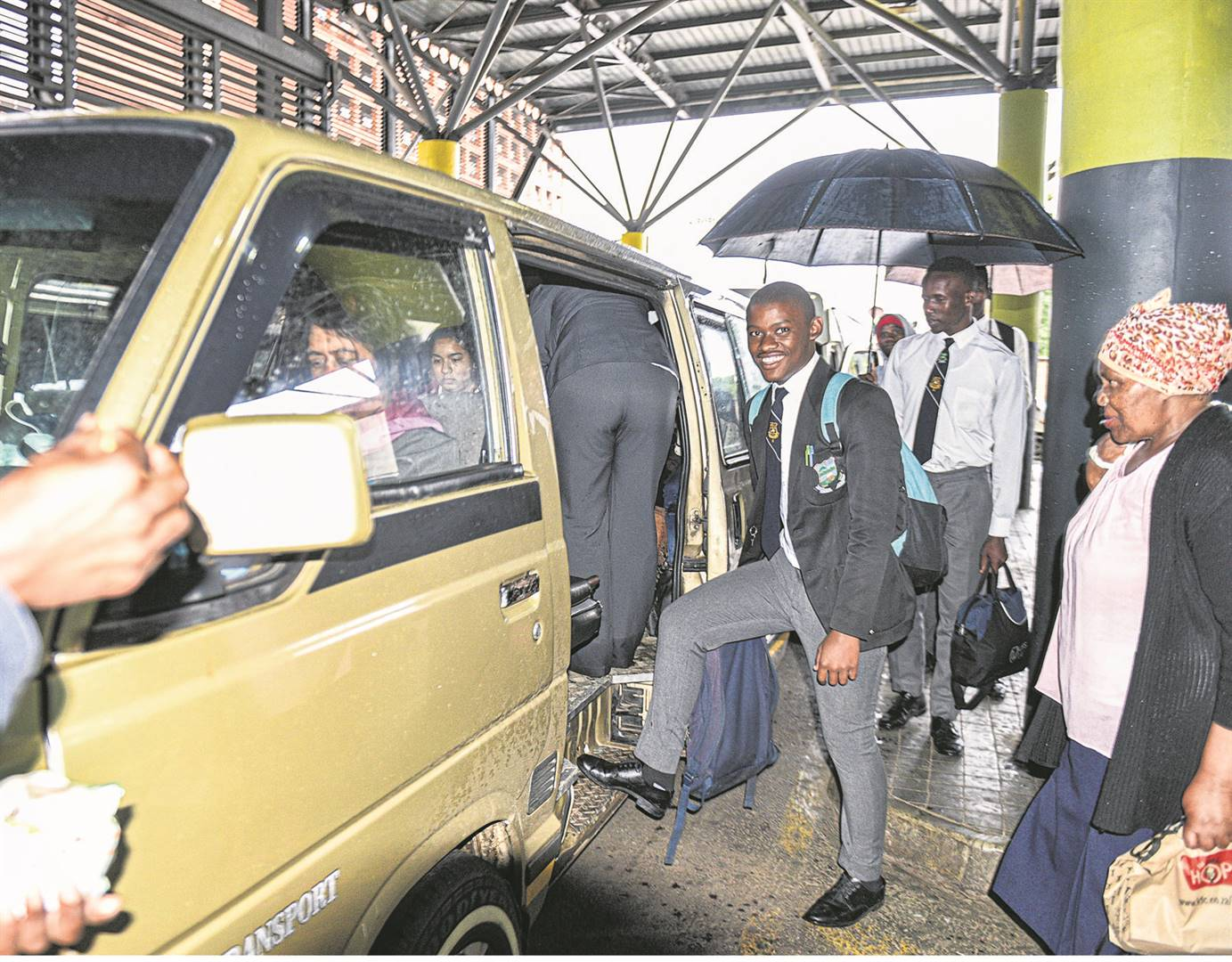 It was business as usual at the city's taxi ranks. Seen boarding a taxi at the Market Square Taxi Rank is Andile Mdlalose from Napierville. Commuters at the rank said they were confident that government would contain the spread of the virus. PHOTO: MOEKETSI MAMANE