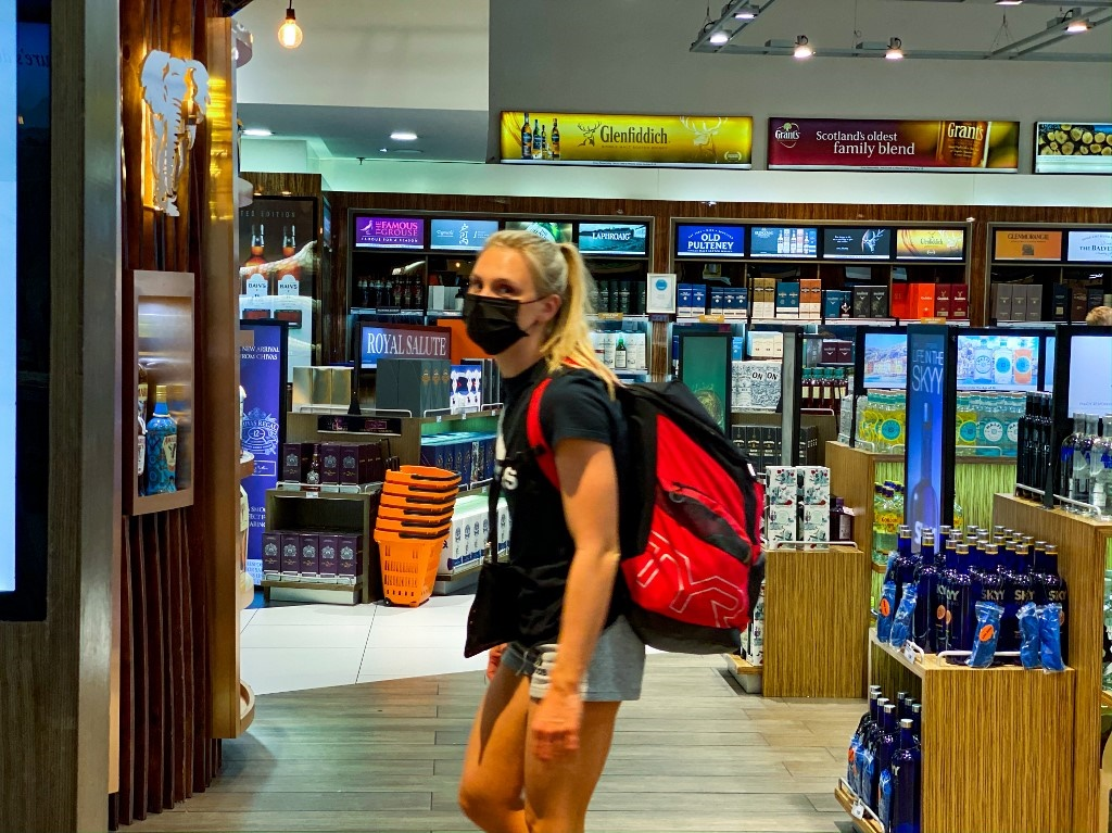 A traveller wears a face mask as a preventive measure at OR Tambo International Airport in Johannesburg. (Guillem Sartorio, AFP)