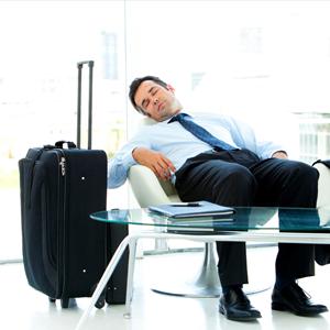 tired man sleeping at airport