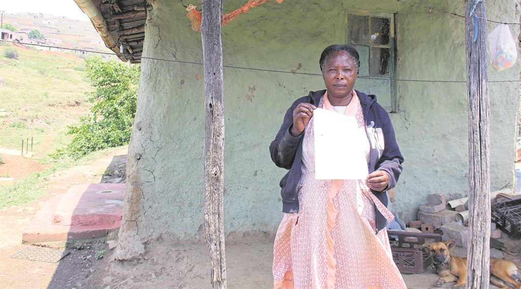 Ngcane Sithole (56) holds a printout from the housing subsidy portal that shows the house number allocated to her matches the house that is being occupied by murder accused Msunduzi councillor Nkosinathi 'TK' Gambu. PHOTO: Sabelo Nsele