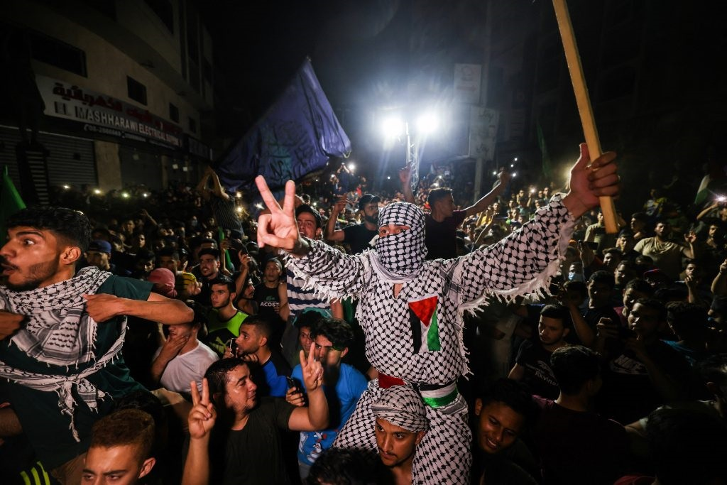 Palestinians celebrate in the streets following a