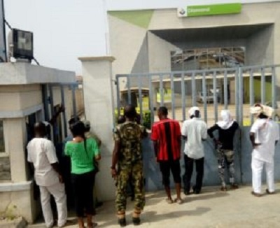 Customers at the gate of the bank