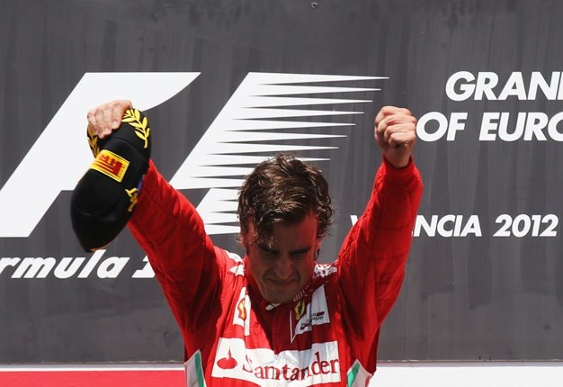 Fernando Alonso celebrates on the podium after winning the European Grand Prix at the Valencia Street Circuit on June 24, 2012.  Image: Mark Thompson/Getty Images