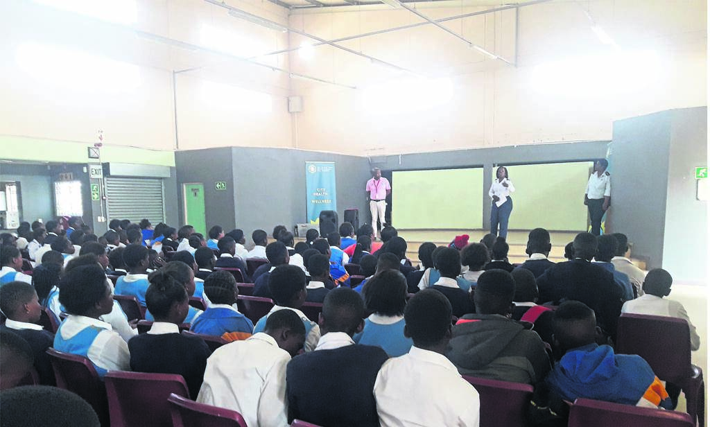 Sr Phathiswa Tukwayo talks to the learners during a TB campaign held at Eyethu hall, while Goodman Makanda (pink t-shirt) from MSF also known as Doctors Without Borders, and Ziyanda Damse (right) from the City look on. PHOTO: unathi obose