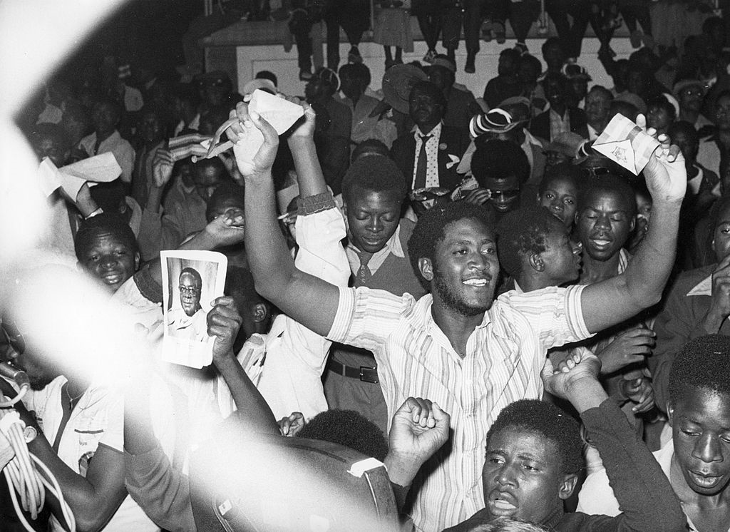 Residents of Salisbury cheering during the ceremony of the proclamation of independence for the nation of Zimbabwe. April 1980. (Photo by: Sovfoto/Universal Images Group via Getty Images)