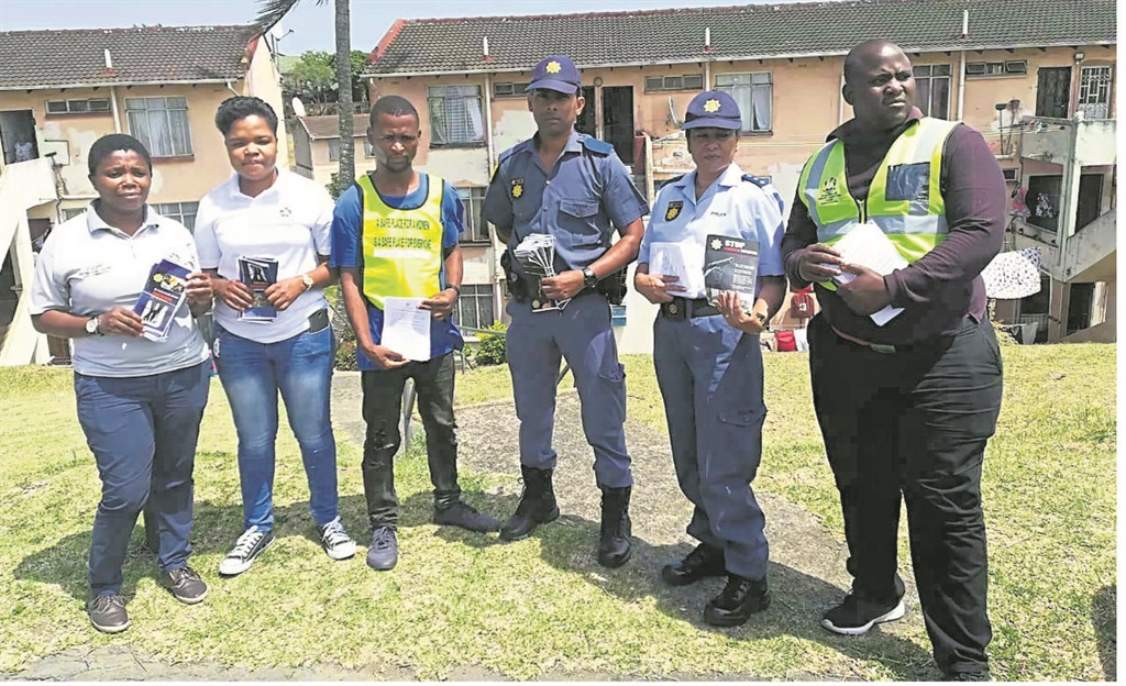 SAPS Tongaat with volunteers during a door-to-door campaign. SAPS Tongaat commemorated World Aids Day last week. A prayer was held and a moment of silence was observed in remembrance of all those who are infected or affected by this virus. A representative from Tongaat Department of Health gave a talk and explained the importance of HIV testing and counselling. Members of the SAPS Tongaat and residents attended the function.PHOTO: supplied