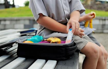child with epi-pen in lunchbox