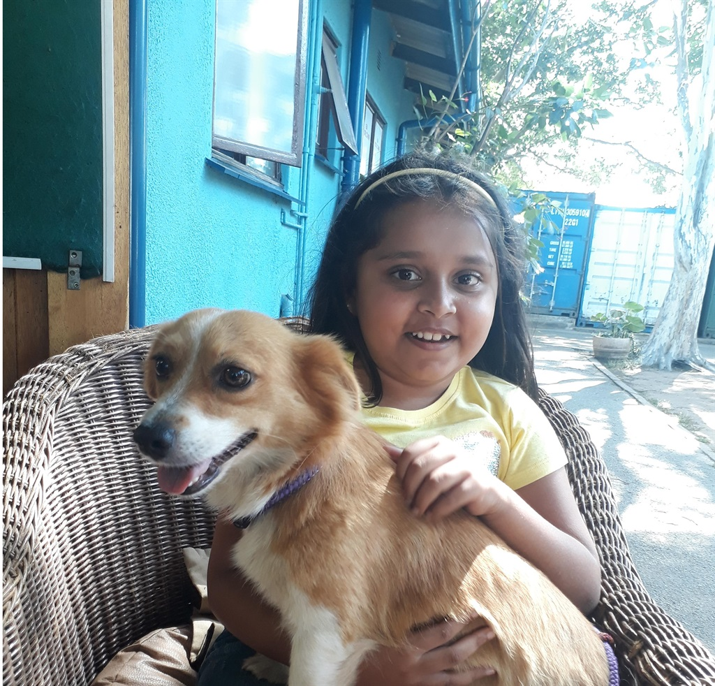 Seen with the adoption dog Cindy is Mikaya Arumugam.PHOTO: supplied