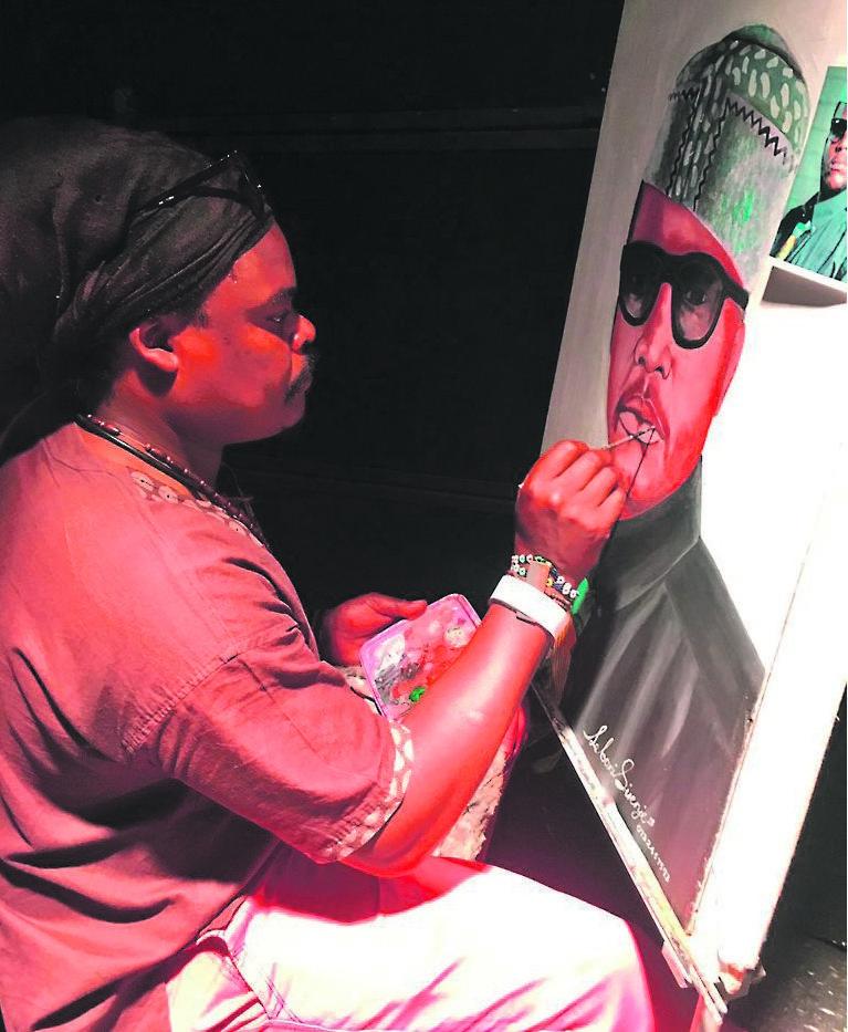 Rasta paints a portrait of Jabulani 'HHP' Tsambo at the rapper's memorial service earlier this year