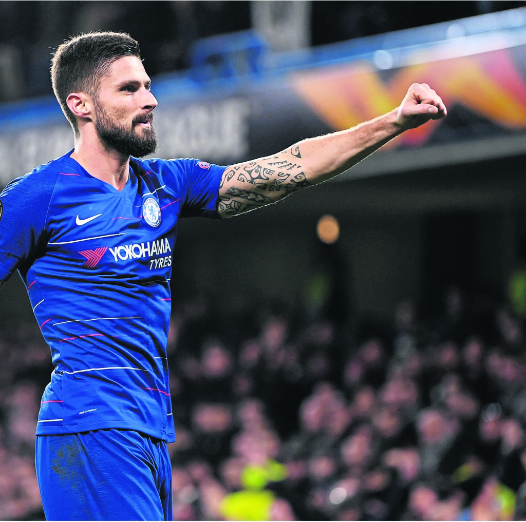 Goals by Olivier Giroud and Marcos Alonso gave Chelsea a 2-1 victory against London rivals Tottenham Hotspur yesterday to strengthen the Blues' hold on fourth place in the Premier League