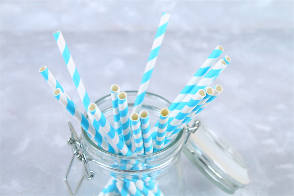Blue striped paper disposable tubes in a jar on a