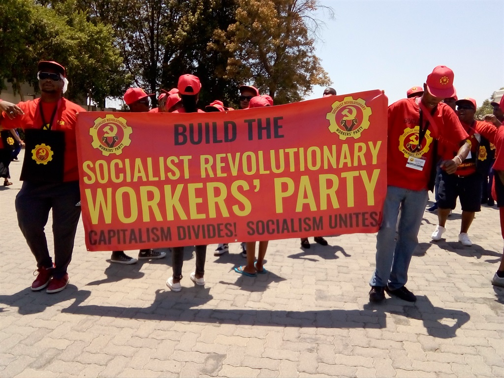 SRWP members hold up the party banner at the pre-launch. Picture: Palesa Dlamini