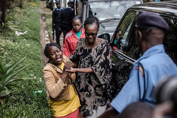 A woman is rescued at the scene of the on-going terrorist