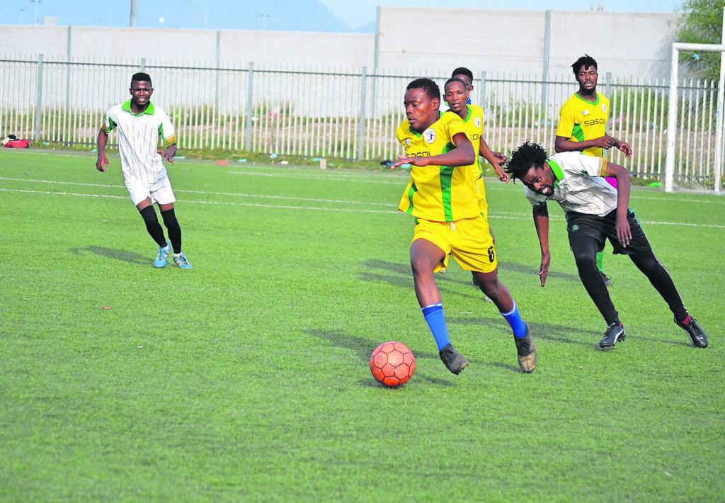 Marikana United (yellow shirts) trying their best Peace Lovers. PHOTO: UNATHI OBOSE