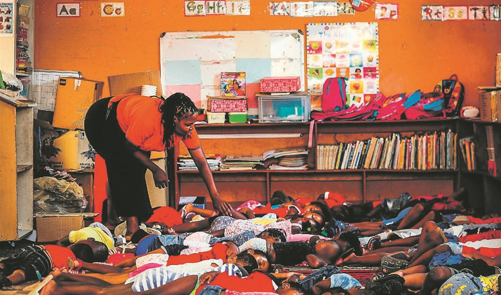 SNOOZE TIME Johanna Ngwenga is a teacher at the Oratile ECD Day Care in Diepsloot Extension 7, Johannesburg. The children – aged four to six – enjoy a nap on a hot afternoon