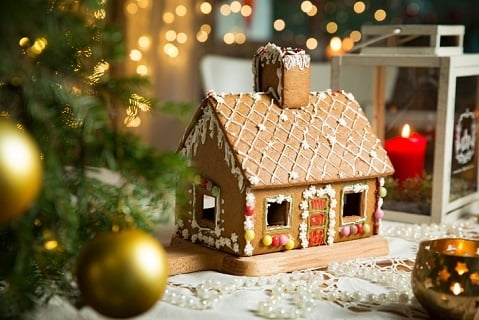 Little gingerbread house with glaze standing on ta