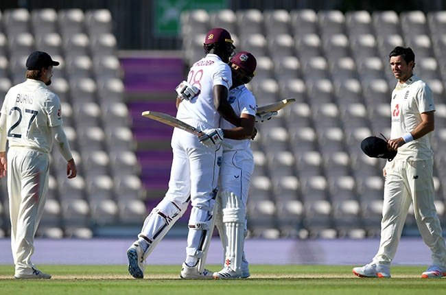 West Indies captain Jason Holder celebrates with John Campbell (Getty).