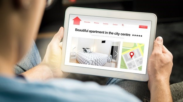 Man search apartments and houses online with mobil