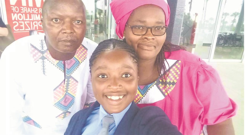 Nqobile Nzimande with her parents, Mshushisi and Phumzile.