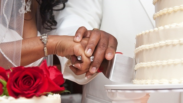 A close up shot of a African American couple bride