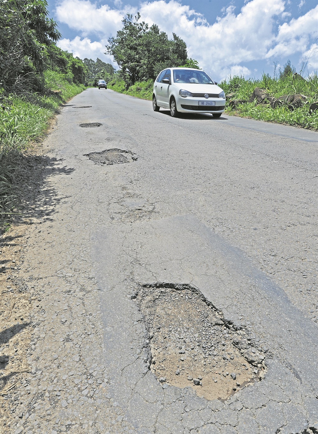A row of pot holes in Old Howick Road before they were repaired.