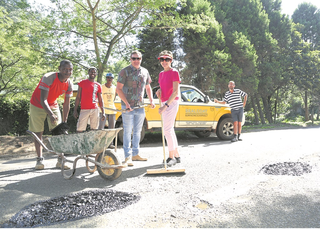 Hard at work on the potholes in Clarendon are (from left) Sphamandla Mchunu, Dan Mthembu, Innocent Mwelese, DA ward councillor Ross Strachan, community member Pam Reach and SealCoat staff member Pete Shuttleworth.