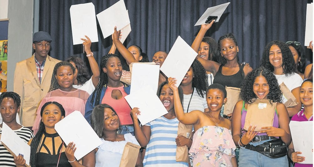 Matriculants pose for a picture after collecting their results.