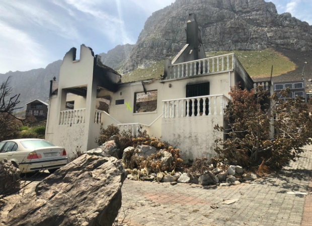 Residents in Betty's Bay are picking up the pieces after the fire. (Kamva Somdyala, News24)