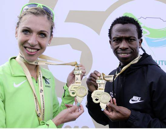Bongmusa Mthembu and Gerda Steyn at the Two Oceans Marathon in Cape Town last year. They are trying to stay positive despite massive disruptions to the athletics calendar due to Covid-19. PHOTO: gallo Images