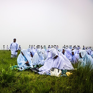 A group of young girls known as makhosazane sit on the top of the Khenana mountain awaiting a sermon by their leader Mduduzi Shembe.