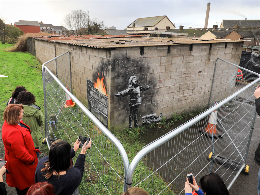 Banksy Mural Discovered on a Garage Sells for Six Figures