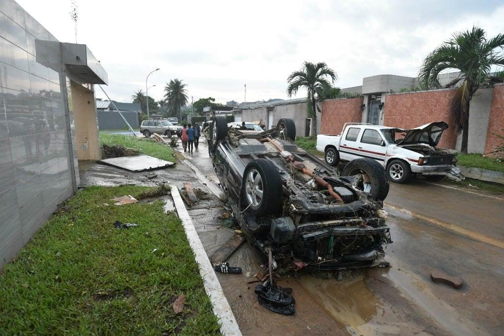Cars swept away by flooding in Alhambra de la Riviera II, a neighbourhood of Cocody, in the district of Abidjan, on June 25, 2020.