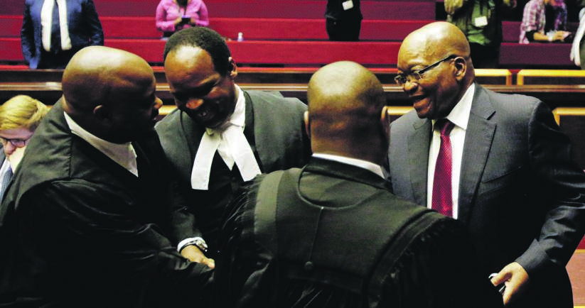 Former president Jacob Zuma speaks to his legal team in court. Picture: Themba Hadebe/Reuters