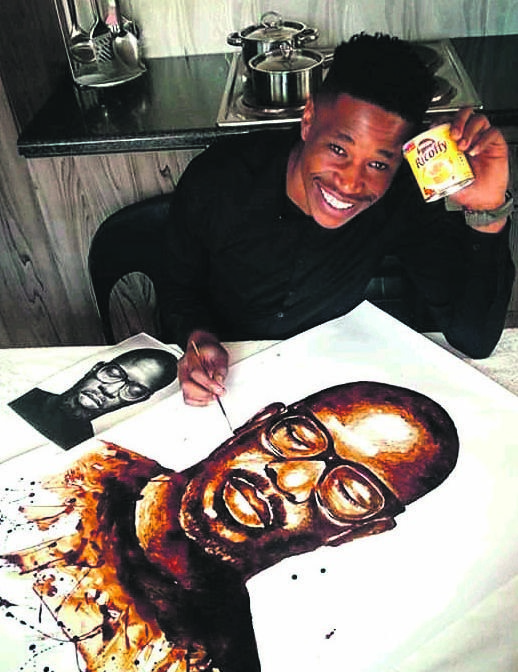 Ennock Mlangeni with the portrait of DJ Black Coffee, painted in coffee, that went viral