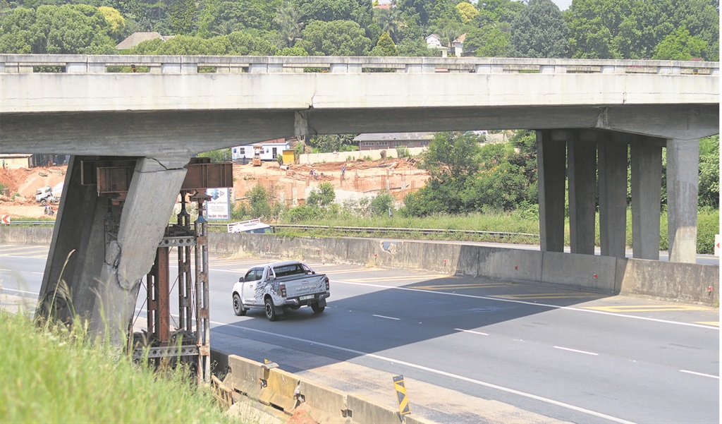 A car drives under the Peter Brown Bridge, passing the pillar that was damaged in 2016. Repairs to the bridge and the section of N3 on Townhill near it have been postponed several times since early 2017.