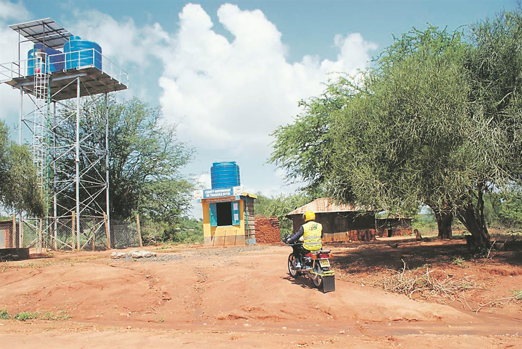 Water is pumped using solar power from a nearby river into these water tanks in Marimanti, a village in eastern Kenya Picture: Kagondu Njagi / Thomson Reuters Foundation