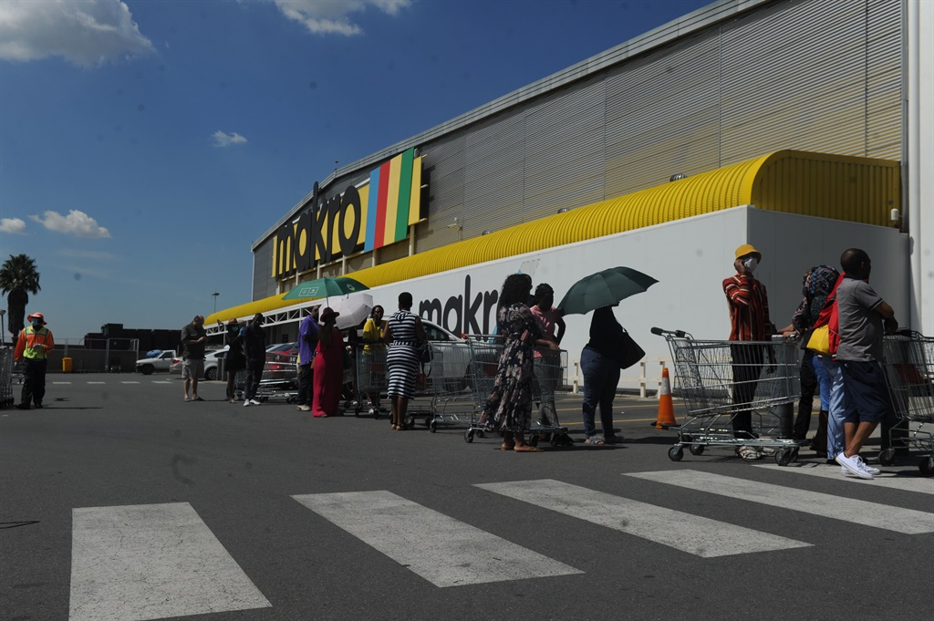 South Africans queue for supplies outside a Makro store in Woodmead, Sandton, on Wednesday (March 25 2020). Picture: Rosetta Msimango/City Press