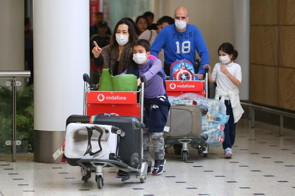 Passengers wearing face masks.