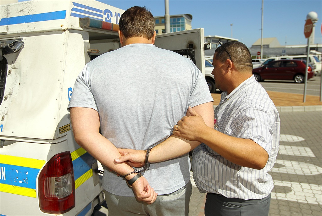 Mark Lifman being arrested in February 2018 (Supplied)