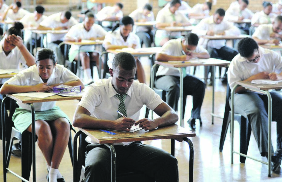 Pupils at William Pescod High School in Kimberley tackle a matric exam paper. The proportion of South Africans who complete Grade 12 is on par with other middle-income countries Picture: Emile Hendricks