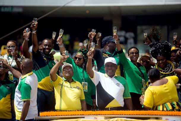 African National Congress (ANC) President Cyril Ramaphosa and former President Jacob Zuma toast during the African National Congress' (ANC) 107th anniversary celebrations at the Moses Mabhida Stadium in Durban on January 12, 2019. - The new head of the ruling ANC and President Cyril Ramaphosa,pledged in tackling unemployment, poverty and inequality. South Africans go to the polls in May 2019. (Photo by Rajesh JANTILAL / AFP)