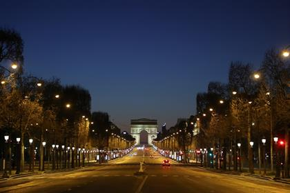 A picture shows the empty Champs-Elysees Avenue an