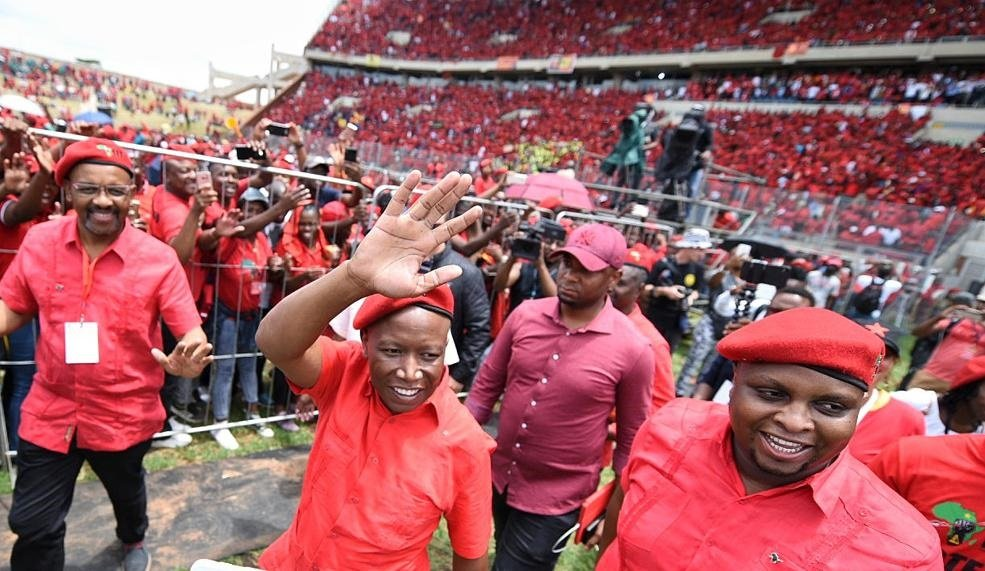 Dali Mpofu, EFF leader Julius Malema and his deputy Floyd Shivambu during the launch of the party's election manifesto for the 2019 general elections, at the Giant Stadium in Soshanguve. (Picture: Tebogo Letsie/City Press)