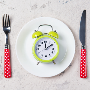 plate with knife, fork and clock