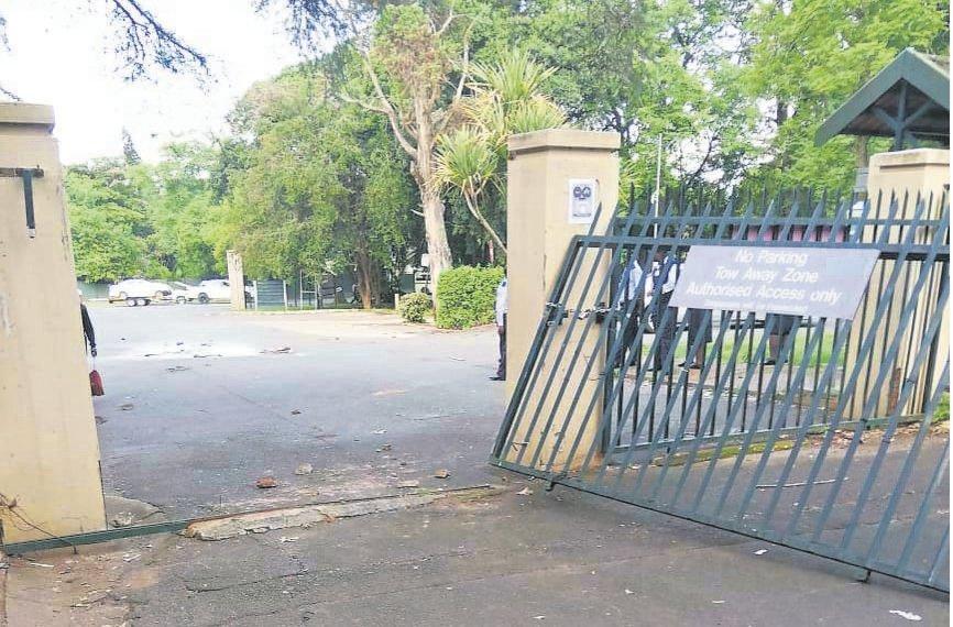 A gate that was derailed by protesting students at the UKZN campus in Alan Paton Avenue on Tuesday afternoon. In the evening, students blocked Ridge Road with tyres and a couch that they set alight, and stoned cars on Alan Paton Avenue, which was also blocked with burning barricades.