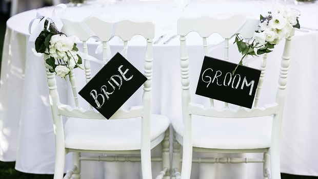 Wedding reception, decorated table with bride and