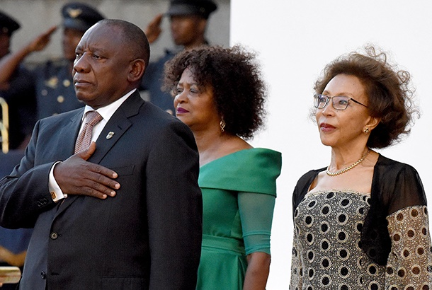 South African President Cyril Ramaphosa (L), First Lady Tshepo Motsepe (R) and speaker of the national assembly, Baleka Mbete (C-back), arrive for the annual State of the Nation address (SONA) on February 07, 2019, at the parliament in Cape Town. (Photo by Nasief Manie / POOL / AFP)