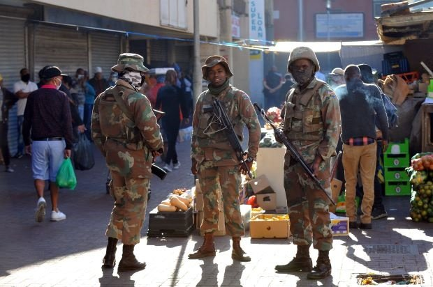 Members of the South African National Defence Force intensify patrols in Mitchells Plain Town Centre. (Photo by Gallo Images/Ziyaad Douglas)